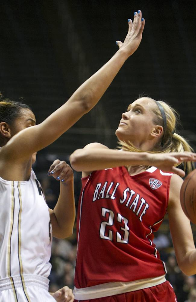 Ball State's Brittany Carter, right, shoots over Purdue's Liza Clemons during an NCAA college basketball game Sunday, Nov. 10, 2013, in West Lafayette, Ind. Purdue defeated Ball State 63-57