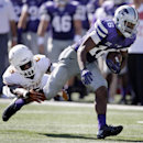 Kansas State wide receiver Tyler Lockett (16) breaks a tackle by Texas cornerback Quandre Diggs (6) during the second half of an NCAA college football game in Manhattan, Kan., in this Oct. 25, 2014 file photo. K-State still has most of its pivotal Big 12