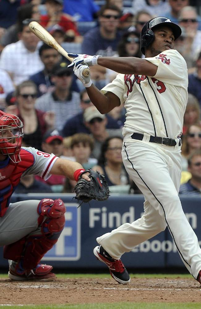Atlanta Braves' Jose Constanza, right, connects for a two-run double to center field during the fifth inning of a baseball game against the Philadelphia Phillies, Sunday, Sept. 29, 2013, in Atlanta