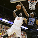 Iowa State forward Dustin Hogue, left, shoots over Georgia State forward Markus Crider during the first half of an NCAA college basketball game, Monday, Nov. 17, 2014, in Ames, Iowa. (AP Photo/Charlie Neibergall)