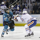 San Jose Sharks center Joe Pavelski (8) tries to get around Edmonton Oilers defenseman Justin Schultz (19) during the first period of an NHL hockey game Tuesday, April 1, 2014, in San Jose, Calif The Associated Press