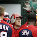 Washington Nationals' Nate McLouth, high-fives teammates after hitting a home run in the sixth inning of an exhibition spring training baseball game against the Miami Marlins, Monday, March 24, 2014, in Jupiter, Fla The Associated Press