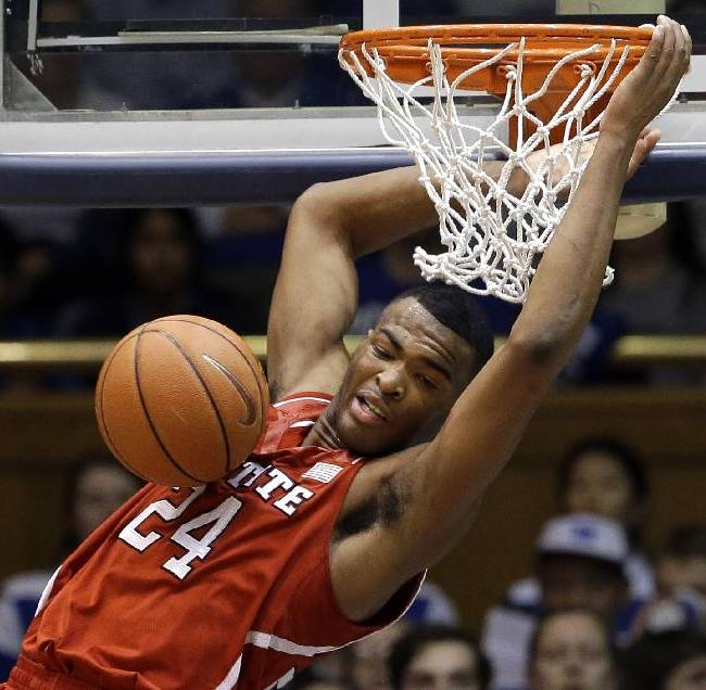 FILE- In this Jan. 18, 2014, file photo, North Carolina State's T.J. Warren (24) dunks against Duke during the second half of an NCAA college basketball game in Durham, N.C. Warren has thrived all season despite facing defenses geared to stop him. The sophomore is leading the Atlantic Coast Conference in scoring by a big margin and is the top scorer among all power-conference teams heading into Sunday's game against Georgia Tech