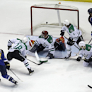 St. Louis Blues' Alex Pietrangelo (27) scores past Dallas Stars goalie Tim Thomas (30) as Stars' Chris Mueller (18), Brenden Dillon (4), Tyler Seguin (91) and Blues' Maxim Lapierre (40) watch during the first period of an NHL hockey game Tuesday, March 11