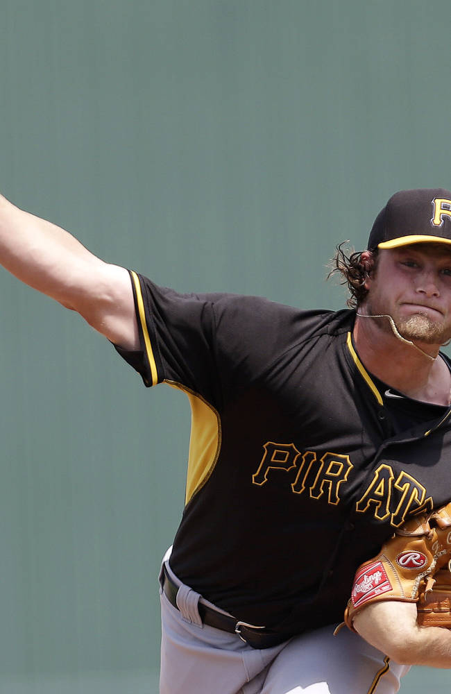 CORRECTS PITCHER TO GERRIT COLE, INSTEAD OF JEFF LIVESEY - Pittsburgh Pirates starter Gerrit Cole pitches in the first inning during an exhibition baseball game against the Minnesota Twins in Fort Myers, Fla., Wednesday, March 12, 2014