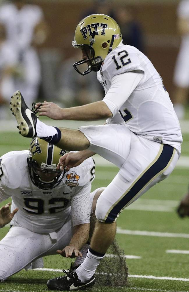 Pittsburgh's Chris Blewitt (12) kicks the go-ahead field goal from the hold of Matt Yoklic during the fourth quarter of the Little Caesars Pizza Bowl NCAA college football game against Bowling Green on Thursday, Dec. 26, 2013, in Detroit. Pittsburgh won 30-27