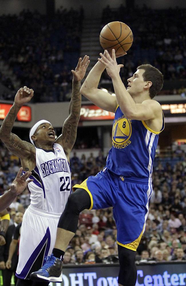 Golden State Warriors guard Nemanja Nedovic,  right, of Serbia, shoots over  Sacramento Kings guard Isaiah Thomas during the first quarter of an NBA basketball game in Sacramento, Calif., Sunday, Dec. 1, 2013