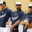 Detroit Tigers manager Brad Ausmus, right, watches a drill as pitchers Joba Chamberlain, center, and Joe Nathan wait to take part before an exhibition spring training baseball game between the Tigers and the Pittsburgh Pirates in Lakeland, Fla., Tuesday,