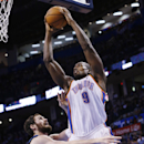 Oklahoma City Thunder forward Serge Ibaka (9) is fouled by Minnesota Timberwolves forward Kevin Love (42) as he shoots in the fourth quarter of an NBA basketball game in Oklahoma City, Sunday, Dec. 1, 2013. Oklahoma City won 113-103 The Associated Press