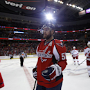 Washington Capitals defenseman Mike Green (52) heads to the bench to celebrate his goal in the second period of an NHL hockey game against the Carolina Hurricanes, Tuesday, Dec. 3, 2013, in Washington. The Hurricanes won 4-1 The Associated Press