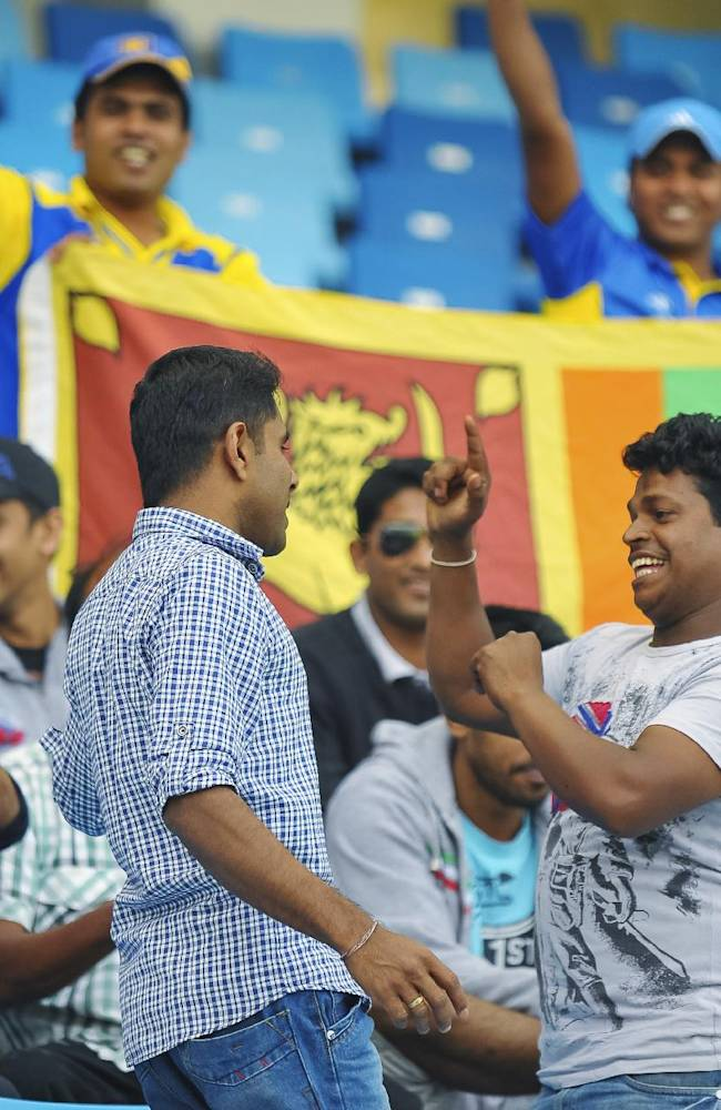 Sri Lanka fans dance during the second cricket test match between Pakistan and Sri Lanka at the Dubai International Cricket Stadium in Dubai, United Arab Emirates, Friday, Jan. 10, 2014