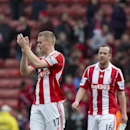 Stoke City's Ryan Shawcross, left, applauds supporters after his team's 1-0 win against Newcastle United in their English Premier League soccer match at the Britannia Stadium, Stoke, England, Saturday April 12, 2014