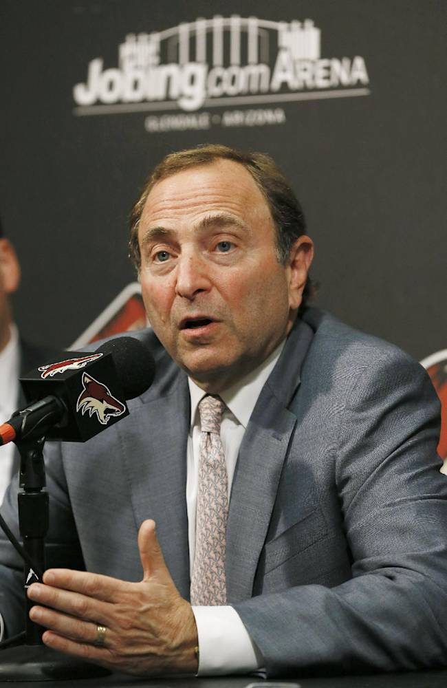 NHL Commissioner Gary Bettman speaks at a new conference before an NHL hockey game between the New York Rangers and the Phoenix Coyotes, Thursday, Oct. 3, 2013, in Glendale, Ariz