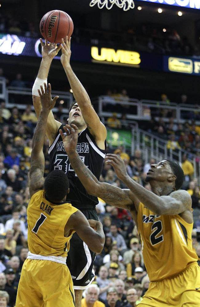 Hawaii forward Christian Standhardinger (34) shoots over Missouri's Wes Clark (1) and Tony Criswell (2) during the second half of an NCAA college basketball game on Saturday, Nov. 16, 2013, in Kansas City, Mo. Missouri won 92-80