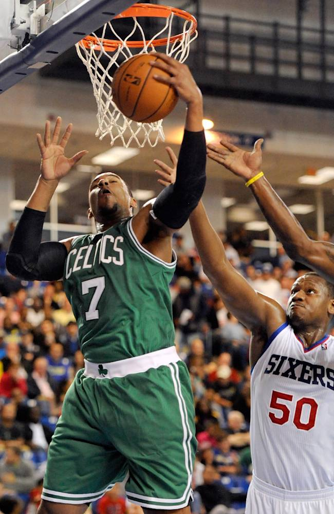 Boston Celtics forward Jared Sullinger (7) pulls down an offensive rebound against Philadelphia 76ers Lavoy Allen (50) in the first quarter of a preseason NBA basketball game Friday, Oct. 11, 2013, in Newark, Del. The 76ers won 97-85