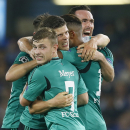 Schalke's Klaas Jan Huntelaar, 3rd from right, is celebrated by his team after scoring during the Champions League Group G soccer match between Chelsea and Schalke 04 at Stamford Bridge stadium in London Wednesday, Sept. 17, 2014