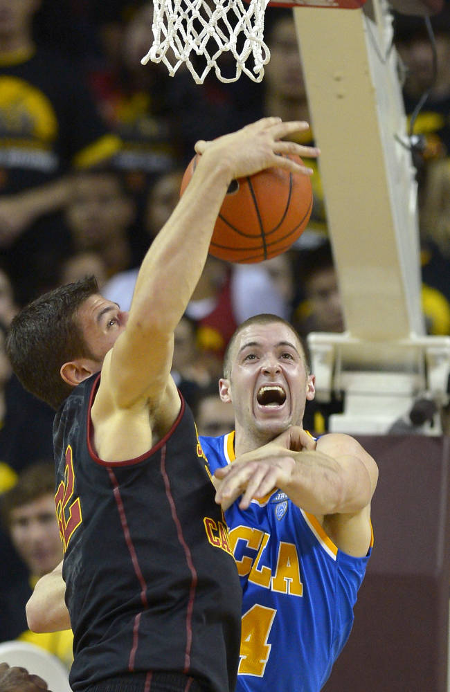 Southern California forward Nikola Jovanovic, left, and UCLA forward Travis Wear battle for a rebound during the second half of an NCAA college basketball game, Saturday, Feb. 8, 2014, in Los Angeles
