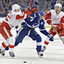 Tampa Bay Lightning center Steven Stamkos (91) tries to cut between Detroit Red Wings defenseman Niklas Kronwall (55), of Sweden, and center Darren Helm (43) during the second period of an NHL hockey game Thursday, Jan. 29, 2015, in Tampa, Fla The Associa