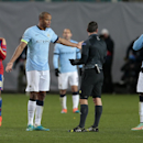 Manchester City's Vincent Kompany, second left, talks to the referee during the Champions League Group E soccer match between CSKA Moscow and Manchester City at Arena Khimki stadium in Moscow, Russia, Tuesday Oct. 21, 2014