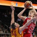 FILE - This Sept. 18, 2011 file photo shows Russia's Andrei Kirilenko going to the basket against a Macedonian defender during the European Basketball Championship bronze match against in Kaunas, Lithuania. The Minnesota Timberwolves have signed free agent Kirilenko, bringing the versatile forward back to the NBA after a one-season absence.  (AP Photo/Mindaugas Kulbis, File)