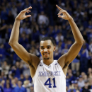 Kentucky's Trey Lyles urges the crowd on during the second half of an NCAA college basketball game against Arkansas, Saturday, Feb. 28, 2015, in Lexington, Ky. Kentucky won 84-67. (AP Photo/James Crisp)