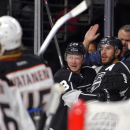 Los Angeles Kings left wing Dwight King, right, celebrates his goal with center Tyler Toffoli, second from right during the second period of a preseason NHL hockey game against the Anaheim Ducks, Thursday, Sept. 25, 2014, in Los Angeles. The Associated Pr