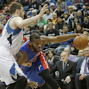 Detroit Pistons' Greg Monroe, right, drives around Minnesota Timberwolves' Kevin Love in the second half of an NBA basketball game, Friday, March 7, 2014, in Minneapolis. The Timberwolves won 114-101. Monroe led the Pistons with 20 points while Love led t