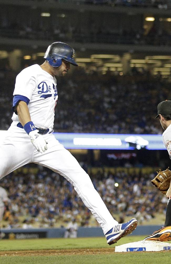 San Francisco Giants first baseman Brandon Belt, right, fields the throw for the out on Los Angeles Dodgers' Andre Ethier during the sixth inning of a baseball game on Thursday, Sept. 12, 2013, in Los Angeles