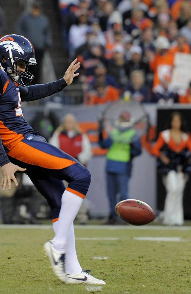 In this Dec. 11, 2011 file photo, Denver Broncos' Britton Colquitt punts during an NFL football game against the Chicago Bears in Denver. The Colquitts are to punting what the Mannings are to passing, and this first family of punters had an inauspicious start, a safety on the patriarch's very first punt at the University of Tennessee in 1975