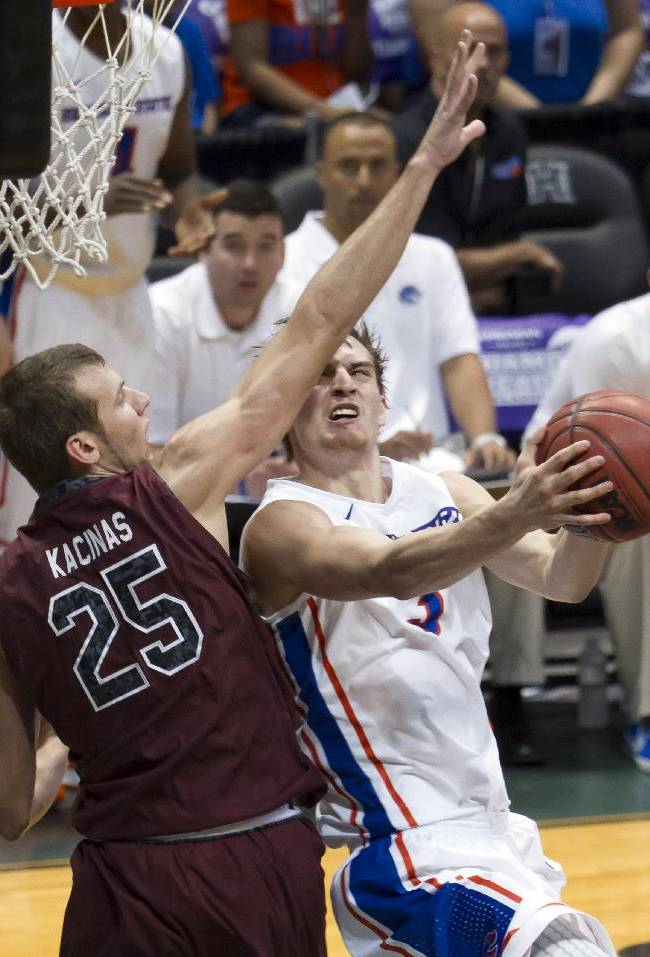 Boise State guard Anthony Drmic, attempts a shot while being defended by South Carolina forward Mindaugas Kacinas (25) in the second half of an NCAA college basketball game at the Diamond Head Classic, Monday, Dec. 23, 2013, in Honolulu. Boise State won 80-54