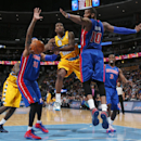 Denver Nuggets guard Aaron Brooks, second from left, drives lane for basket as, from left, Detroit Pistons forward Charlie Villanueva, center Greg Monroe and guard Rodney Stuckey cover in the fourth quarter of the Nuggets' 118-109 victory in an NBA basket