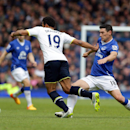Everton's Gareth Barry, right, tackles Tottenham Hotspur's Mousa Dembele battle for the ball during the Englihs Premier League soccer match at Goodison Park, Liverpool, England, Sunday May 24, 2015. (Clint Hughes/PA via AP) UNITED KINGDOM OUT NO