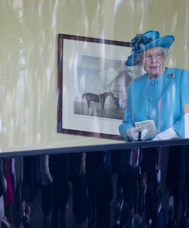 Britain's Queen Elizabeth II looks out of the Royal Box just before the start of the Gold Cup race in which her horse Estmate finished second behind Leading Light, on the third day of the Royal Ascot horse racing meeting, which is traditionally known as Ladies Day, at Ascot, England,  Thursday, June, 19, 2014.  Royal Ascot the annual five day horse race meeting that Britain's Queen Elizabeth II attends every day of the event