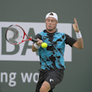 Lleyton Hewitt, of Australia, returns a shot against Matthew Ebden, also of Australia, during a first-round match at the BNP Paribas Open tennis tournament on Thursday, March 6, 2014, in Indian Wells, Calif. (AP Photo/Mark J. Terrill)