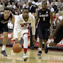 UNLV's Deville Smith chases after a loose ball with San Diego State's Xavier Thames, left, Daniel Bejarano and Winston Shepard during the second half of an NCAA college basketball game on Wednesday, March 5, 2014, in Las Vegas. San Diego State defeated UN