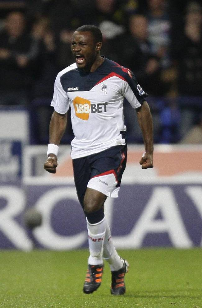 Bolton's Nigel Reo-Coker celebrates after scoring against Tottenham during their English Premier League soccer match at The Reebok Stadium, Bolton, England, Wednesday, May 2, 2012