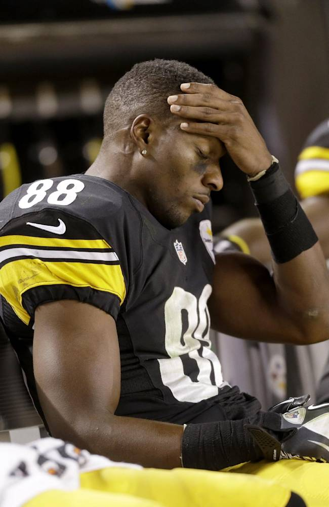 Pittsburgh Steelers wide receiver Emmanuel Sanders (88) holds his head as his team is losing to the Chicago Bears in the fourth quarter of an NFL football game in Pittsburgh, Sunday, Sept. 22, 2013. The Steelers lost 40-23