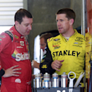 \Kyle Busch, left, talks with Carl Edwards during practice for the NASCAR Sprint Cup Brickyard 400 auto race at Indianapolis Motor Speedway in Indianapolis, Friday, July 24, 2015. (AP Photo/R Brent Smith)