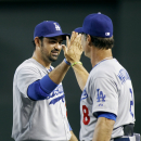 Los Angeles Dodgers' Adrian Gonzalez, left, is congratulated by manager Don Mattingly (8) after they defeated the Arizona Diamondbacks 8-6 in a baseball game on Sunday, April 13, 2014, in Phoenix The Associated Press
