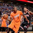 PHOENIX, AZ - JANUARY 30: Eric Bledsoe #2 of the Phoenix Suns drives against Derrick Rose #1 of the Chicago Bulls on January 30, 2015 at U.S. Airways Center in Phoenix, Arizona. (Photo by Barry Gossage/NBAE via Getty Images)