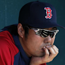 Boston Red Sox relief pitcher Koji Uehara sits in the dugout before an exhibition spring training baseball game against the Pittsburgh Pirates in Bradenton, Fla., Monday, March 3, 2014 The Associated Press