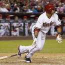 Arizona Diamondbacks' Gerardo Parra connects for a two-run single against the San Francisco Giants during the fourth inning of an opening day baseball game, Monday, March 31, 2014, in Phoenix The Associated Press