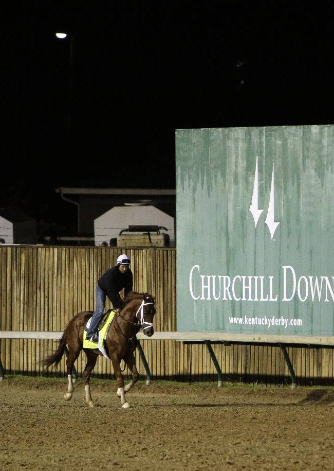 Exercise rider Ezequiel Perez takes Kentucky Derby hopeful Danza for a workout at Churchill Downs Monday, April 28, 2014, in Louisville, Ky