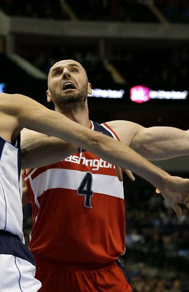 Dallas Mavericks' Dirk Nowitzki (41) strips the ball from Washington Wizards' Marcin Gortat (4) during the first half of an NBA basketball game, Tuesday, Nov. 12, 2013, in Dallas