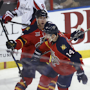 Florida Panthers' Jesse Winchester (17) celebrates with Tomas Fleischmann (14) after Fleischmann scored against the Washington Capitals during the first period of an NHL hockey game, Thursday, Feb. 27, 2014, in Sunrise, Fla The Associated Press