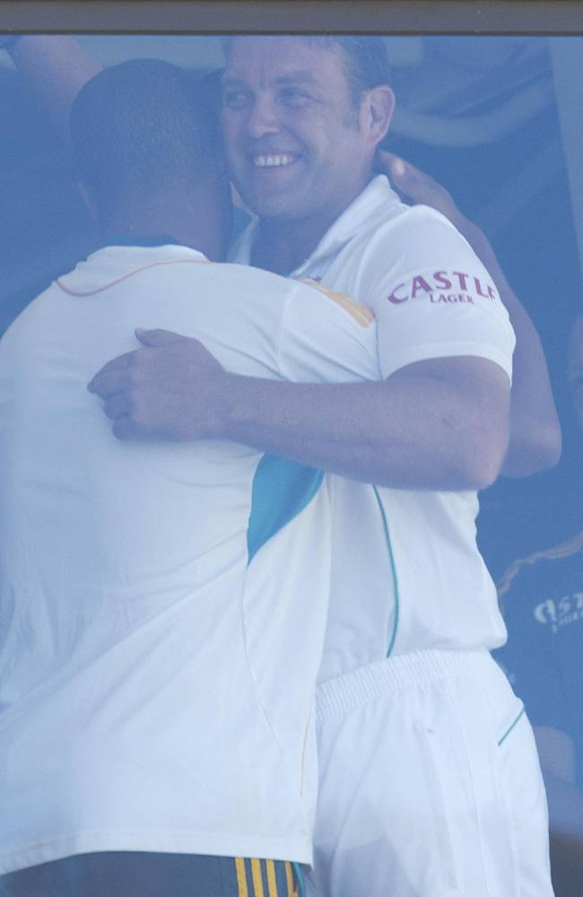 South Africa's Jacques Kallis, right, embraces teammate Vernon Philander in the pavilion after retiring from Test cricket at the end of their fifth and final day of their cricket test match against India at Kingsmead stadium, Durban, South Africa, Monday, Dec. 30, 2013. South Africa beat India by 10 wickets