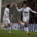 Manchester United's Robin Van Persie, right, celebrates his penalty goal against Crystal Palace with teammate Juan Mata during their English Premier League soccer match at Selhurst Park, London, Saturday, Feb. 22, 2014
