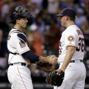 Houston Astros catcher Jason Castro, left, and closer Will Harris (36) shake after beating the Kansas City Royals 6-1 in a baseball game Monday, June 29, 2015, in Houston. (AP Photo/Pat Sullivan)