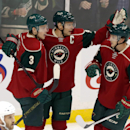 Minnesota Wild's Mikko Koivu, center, of Finland celebrates with Charlie Coyle, left, and Jonas Brodin, right, of Sweden following Koivu's goal off Tampa Bay Lightning goalie Evgeni Nabokov of Kazakhstan in the first period of an NHL hockey game, Saturday