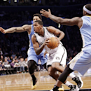 Brooklyn Nets guard Joe Johnson, center, drives past two Denver defenders in the first half of an NBA basketball game Tuesday, Dec. 3, 2013, in New York The Associated Press